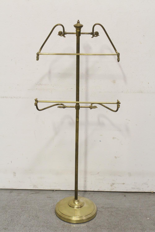 Lot 91: A cast iron towel rack, and a brass cloth hanger