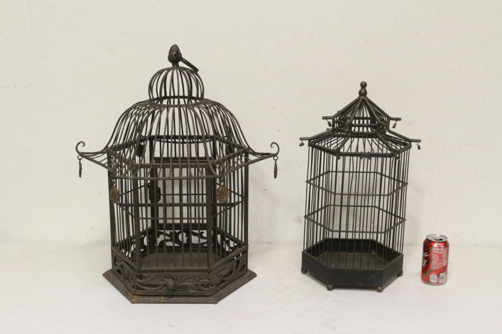 2 cast iron bird cages