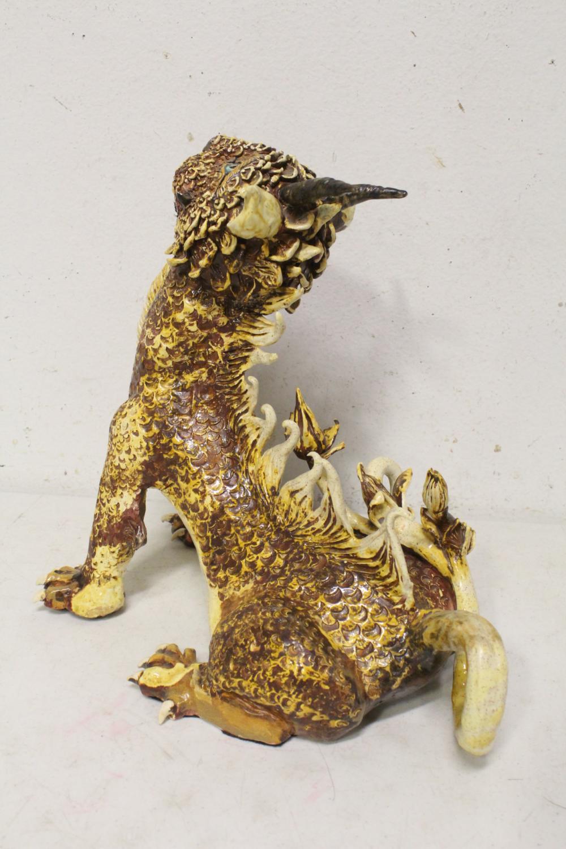 Lot 107: Unusual pottery sculpture of qilin