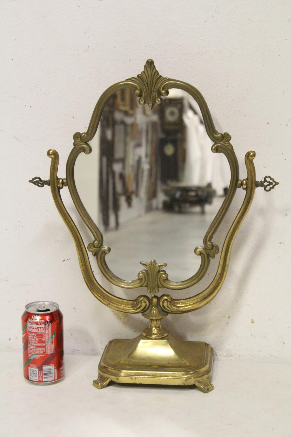 Lot 113: French brass/bronze framed table mirror