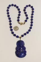 Lot 191: Chinese lapis pendant w/ lapis & gold bead necklace