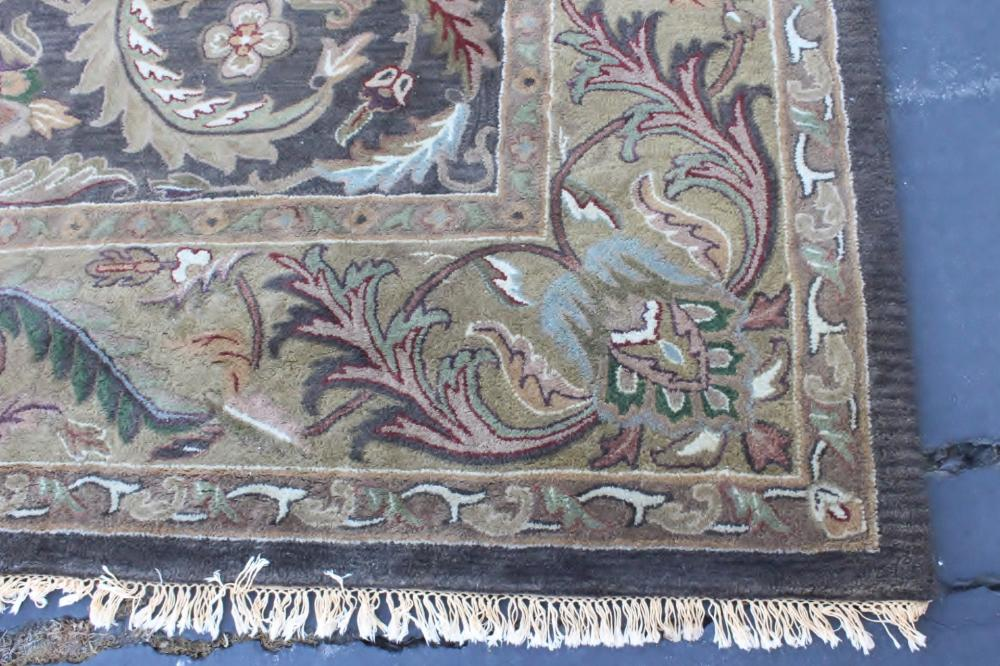 Lot 155: A beautiful room size 100% wool hand craft rug