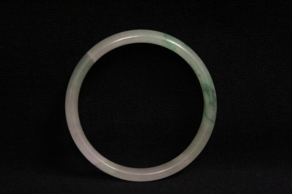 Lot 195: Chinese vintage children translucent jadeite bangle