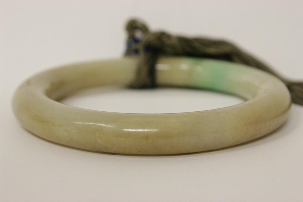 Lot 198: Chinese antique jadeite bangle bracelet