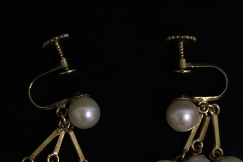 Lot 197: Pair 14K Y/G cultured pearl earrings
