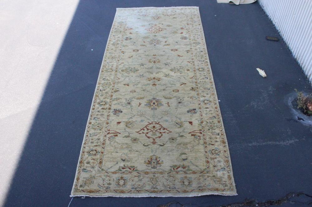 A large handmade vintage ivory background runner