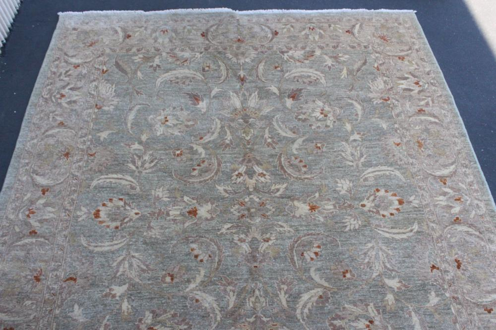 Lot 165: A large handmade vintage Persian rug