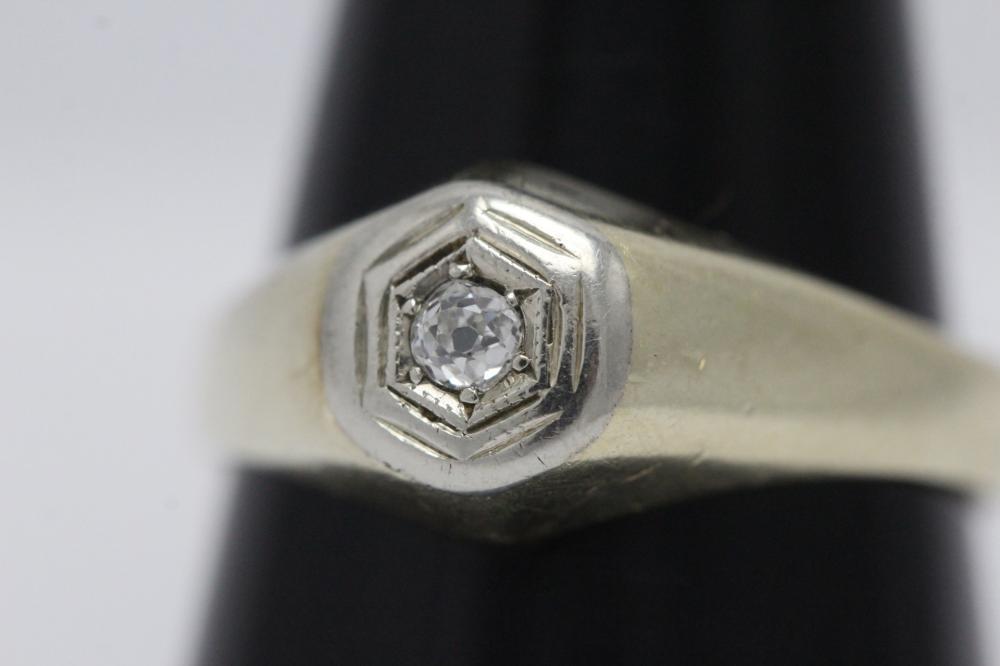 Lot 203: 14K deco Y/G diamond ring