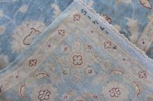 Lot 166: A palace size handmade wool Persian rug
