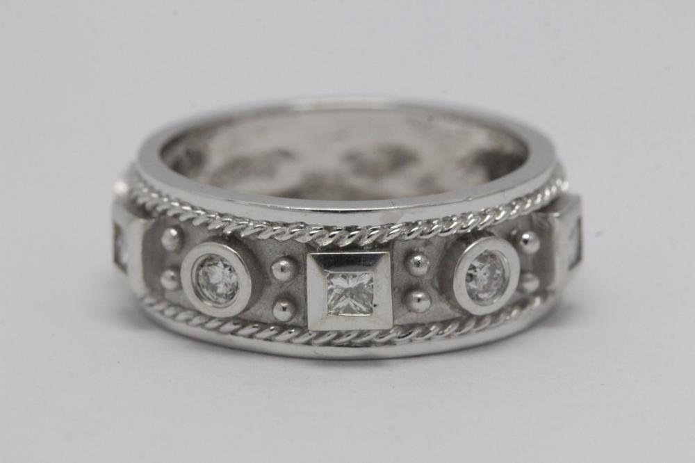 Lot 209: Beautiful 14K W/G diamond ring