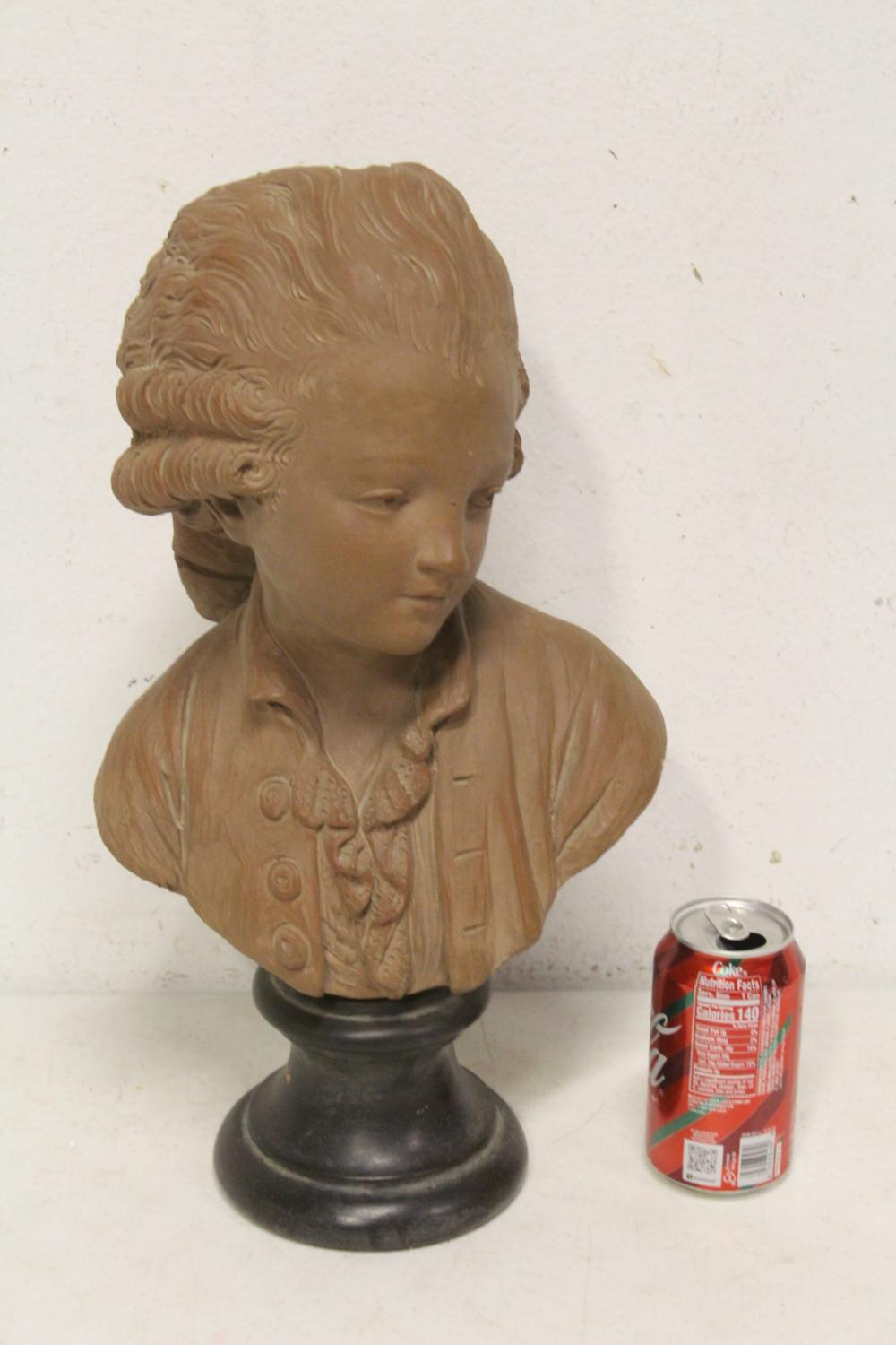 A pottery/bisque sculpture to depict bust of boy