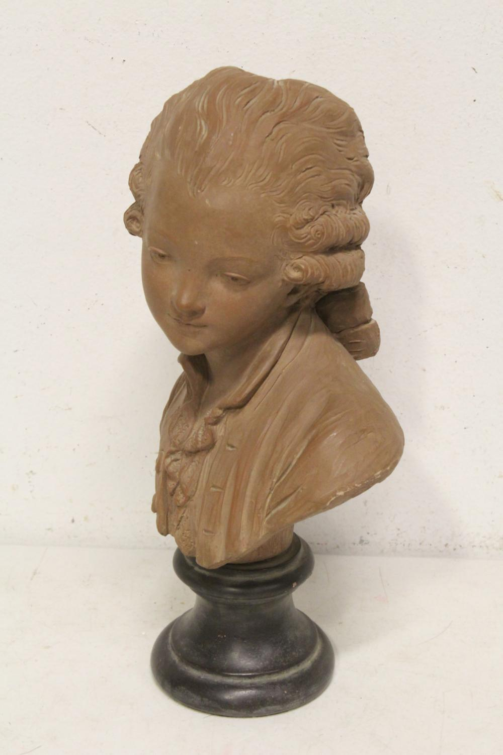 Lot 100: A pottery/bisque sculpture to depict bust of boy