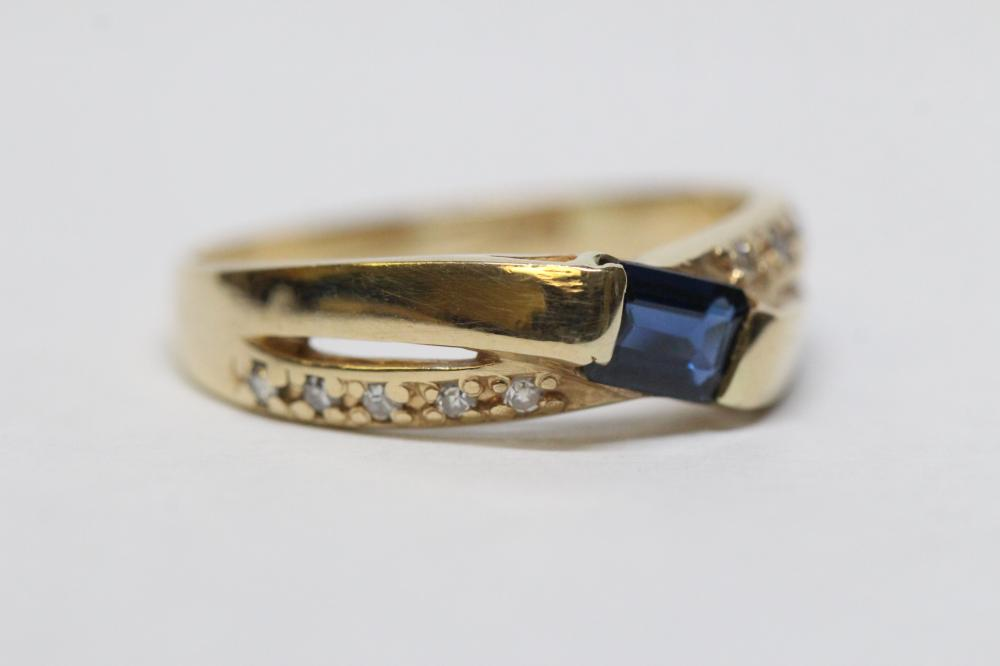 Lot 212: 14K Y/G ring w/ blue sapphire and diamonds
