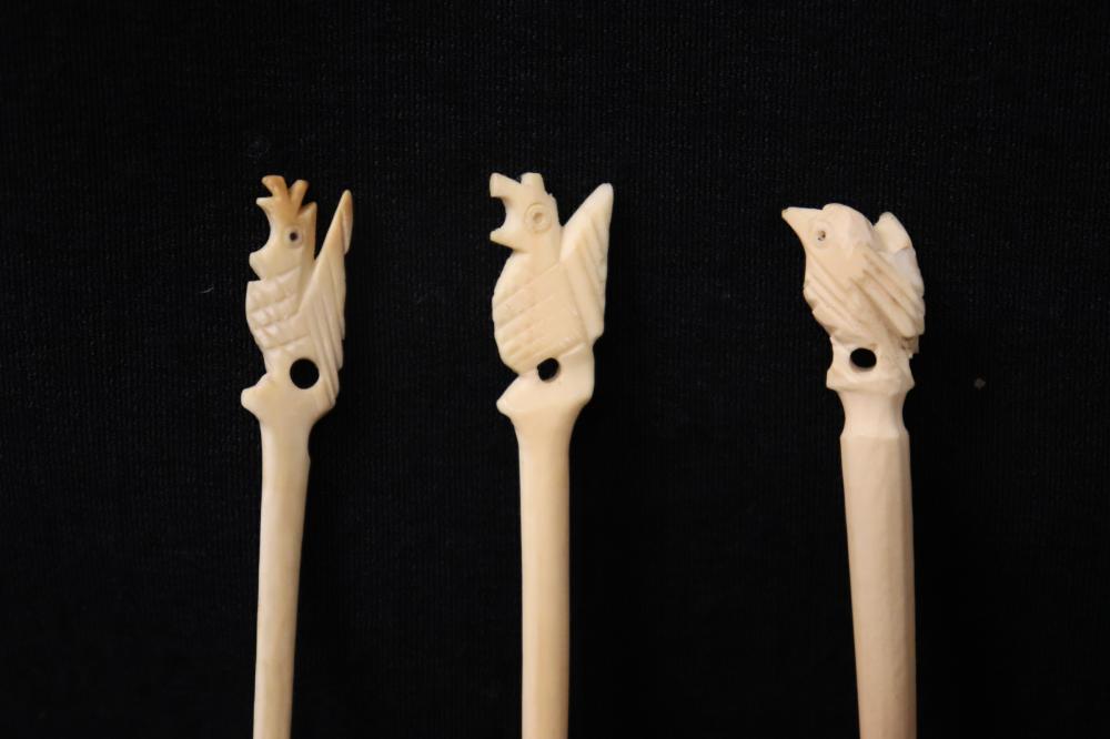 Lot 121: Large lot Chinese bone carved fruit picks