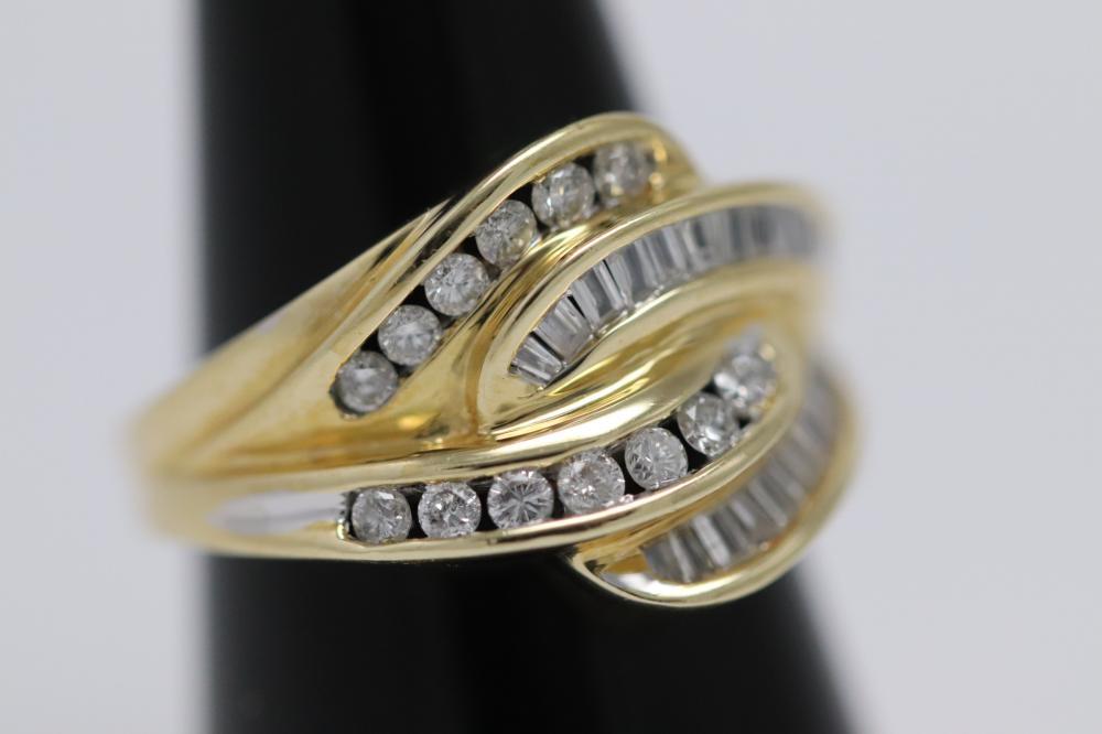 Lot 220: 14K Y/G diamond ring