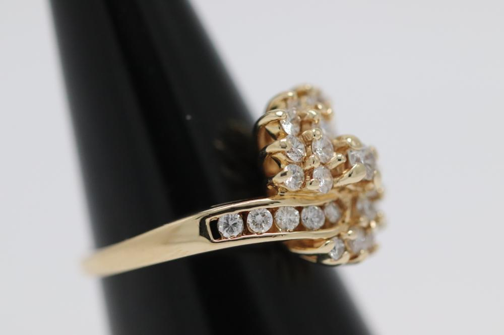 Lot 223: 14K Y/G diamond cocktail ring