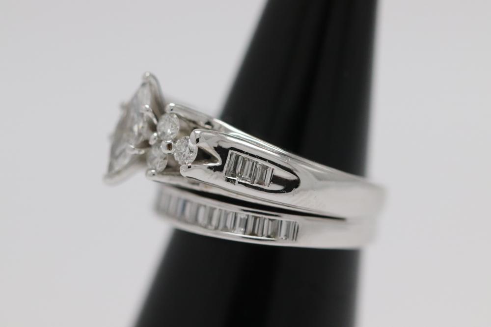 Lot 222: 14K W/G double diamond ring