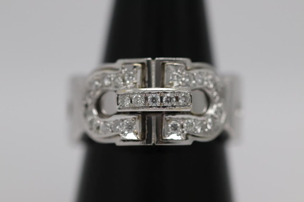 A beautiful 18K W/G Cartier style diamond ring