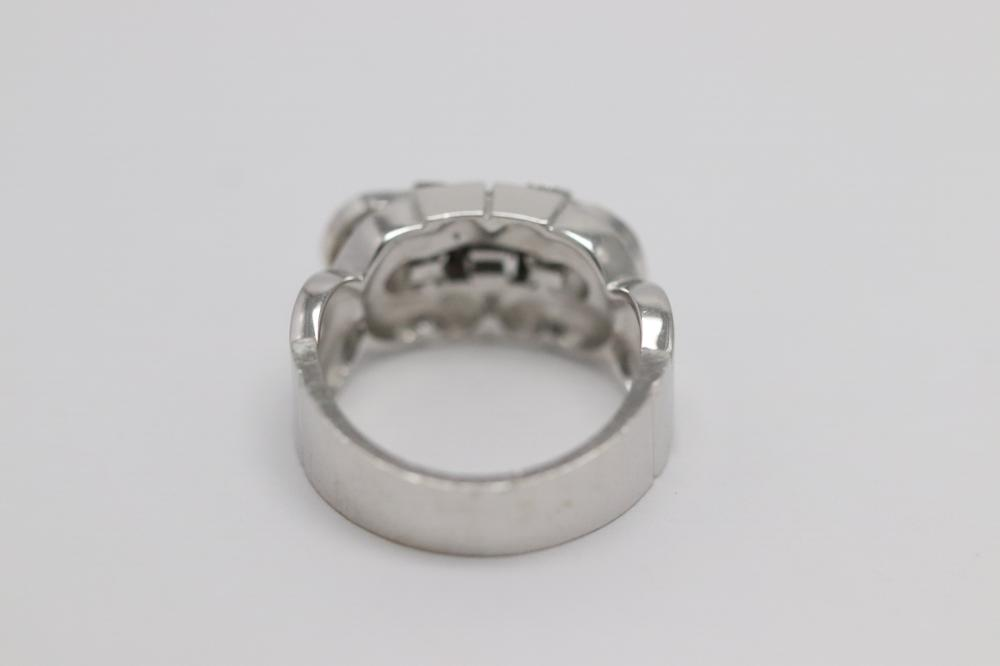 Lot 224: A beautiful 18K W/G Cartier style diamond ring