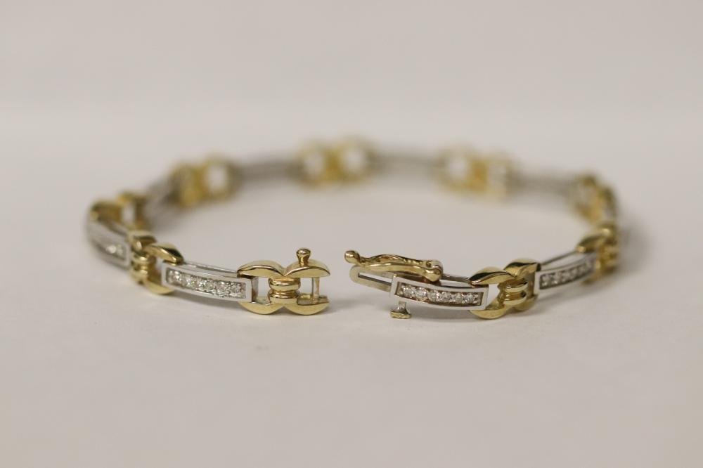 Lot 231: 14K W/G and Y/G diamond bracelet