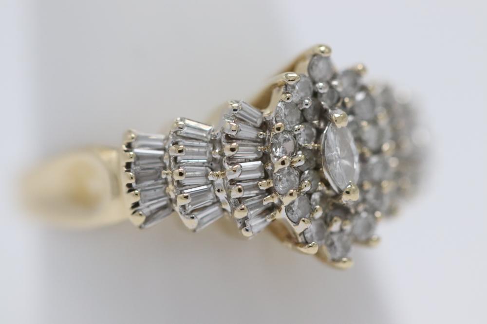 Lot 229: 14K Y/G diamond rings