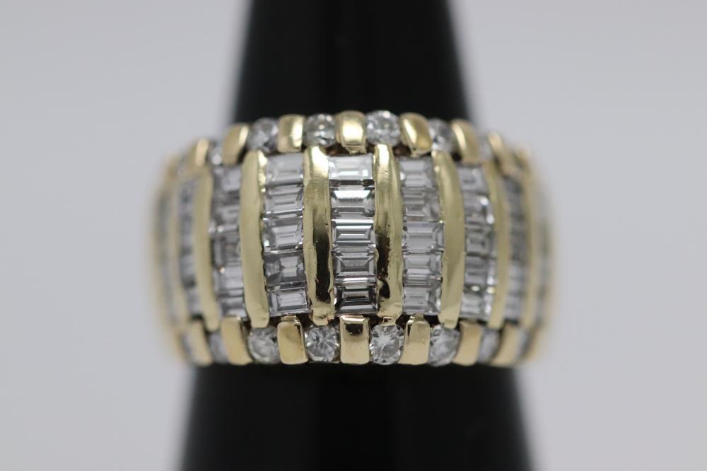 Lot 230: 14K Y/G diamond ring