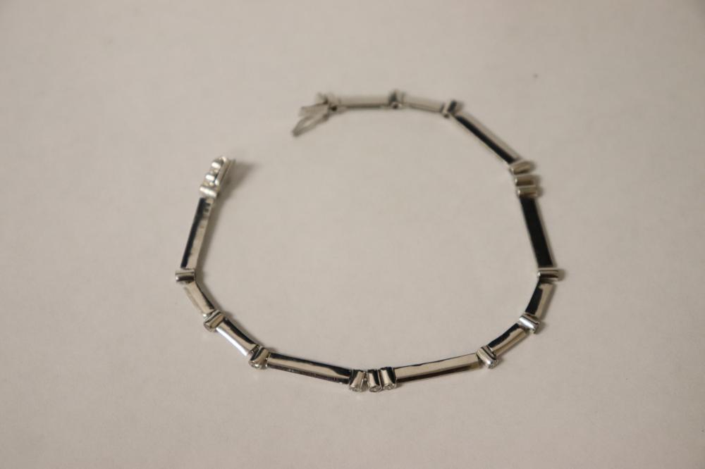 Lot 234: A beautiful 14K W/G diamond bracelet
