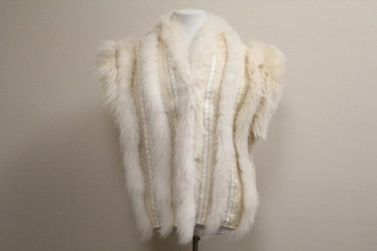 lady's half length coat with white fox fur trim