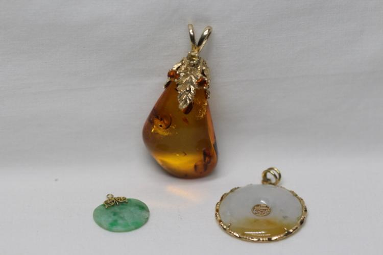 2 jadeite pendant, and one amber pendant
