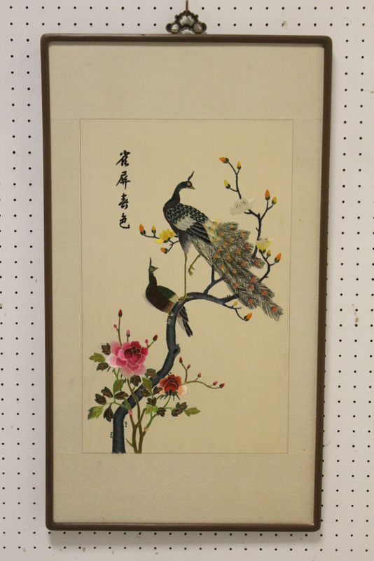 Framed embroidery depicting peacocks