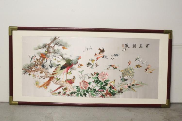 A large framed embroidery panel