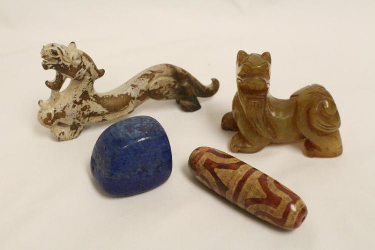 A lapis stone, an agate dzi bead, and 2 jade carved animals
