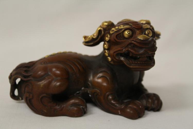 A parcel gilt bronze sculpture of qilin