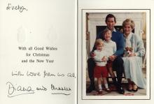 CHARLES & DIANA: CHARLES (1948- ) Prince of Wales & DIANA (1961-1997) Princess of Wales. Signed and inscribed Christmas greetings card by both Prince Charles and Princess Diana individually, the stiff white 8vo folding card featuring a colour photograph to the inside of the Royal couple, seated in full-length poses, together with their young sons, Prince William and Prince Harry. Signed and inscribed by Princess Diana in black fountain pen ink 'Evelyn….with love from us all, from Diana' above and below a printed greeting and signed ('and Charles') by the Prince in bold black fountain pen ink. With two gold embossed crests to the front cover, which is dated 1986 in pencil to the top right corner. EX Evelyn Dagley - Royal Aide, the Personal Dresser to Princess Diana from 1981-92. Dagley was the only female to accompany Prince Charles and Princess Diana on their honeymoon aboard the royal yacht Britannia.