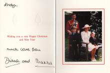 CHARLES & DIANA: CHARLES (1948- ) Prince of Wales & DIANA (1961-1997) Princess of Wales. Signed and inscribed Christmas greetings card by both Prince Charles and Princess Diana individually, the stiff white 8vo folding card featuring a colour photograph to the inside of the Royal couple, Diana seated on a bench, Prince Charles standing behind her, together with their young sons, Prince William and Prince Harry. Signed and inscribed by Princess Diana in black fountain pen ink 'Evelyn….much love from Diana and' above and below a printed greeting and signed ('Charles') by the Prince in bold black fountain pen ink with his name alone. With two gold embossed crests to the front cover. Accompanied by the original envelope addressed to Miss Evelyn Dagley at Kensington Palace and dated 1988 in pencil. EX Evelyn Dagley - Royal Aide, the Personal Dresser to Princess Diana from 1981-92. Dagley was the only female to accompany Prince Charles and Princess Diana on their honeymoon aboard the royal yacht Britannia.