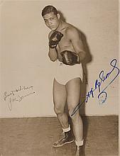 LOUIS JOE: (1914-1981) American Boxer, World Heavyweight Champion 1937-49. Vintage signed sepia 7 x