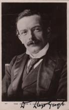 LLOYD GEORGE DAVID: (1863-1945) British Prime Minister 1916-22. Vintage signed postcard photograph, the image depicting Lloyd George seated in a half-length pose. Signed in bold black fountain pen ink with his name alone to the lower border. Slight traces of former mounting to the verso. Together with Lewis Harcourt (1863-1922) British Politician, committed suicide as revelations of his sexual deviancy were about to be made public. Vintage signed postcard photograph, the image depicting the M.P. seated in a three-quarter length pose at a desk. Signed in black fountain pen ink with his name alone to the image. Also including John Profumo (1915-2006) British Politician whose career ended in 1963 after a sexual relationship with the 19-year-old model Christine Keeler in 1961. T.L.S., John Profumo, with holograph salutation and subscription, one page, 4to, London, 9th March 1989, to Mrs. J. Hind. Profumo thanks his correspondent for her letter, continuing, 'What you had to say is most encouraging at a time like this.' Written six days after the release of Scandal, a film which chronicled the Profumo Affair. Accompanied by the original envelope. G to VG, 3