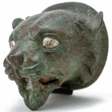 Roman Bronze Panther Head Ornament with Silver Inlay