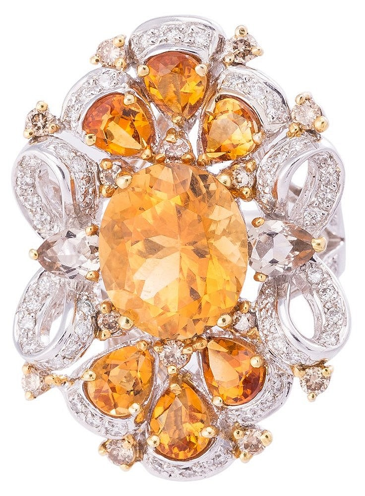 A GOLD, TOPAZ AND DIAMOND RING