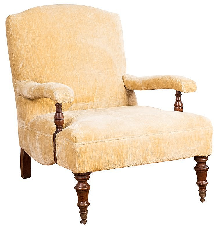 AN ENGLISH YELLOW VELVET ARMCHAIR
