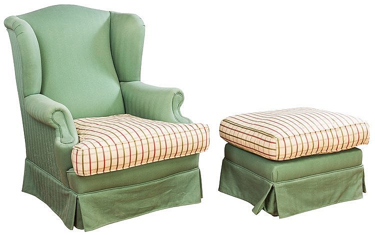 AN ARMCHAIR AND MATCHING FOOTSTOOL, 20TH CENTURY