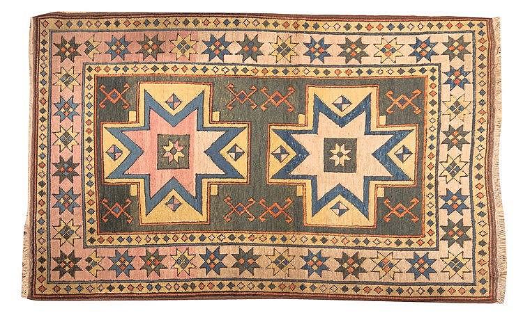 A KAZAK WOOL CARPET, 20TH CENTURY
