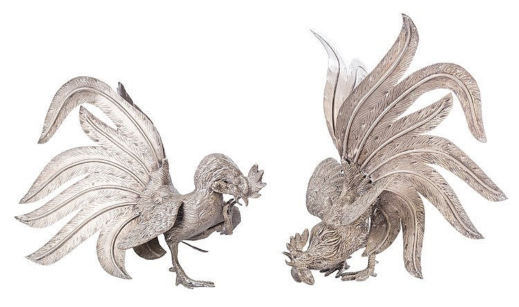A PAIR OF SILVER METAL ROOSTER FIGURES, 2OTH CENTURY
