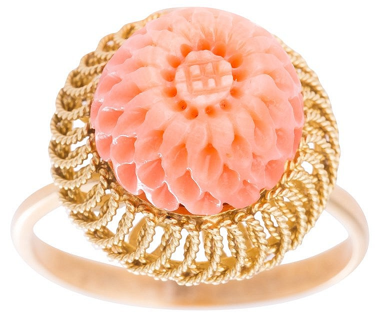 A GOLD AND CORAL RING