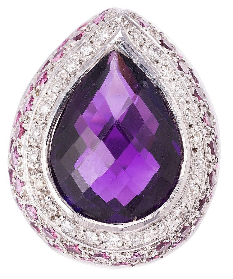 A GOLD, AMETHYST, GARNET AND DIAMOND RING