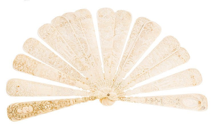 A GERMAN CARVED IVORY HAND FAN, CIRCA 1860