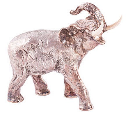 A SILVER AND IVORY ELEPHANT FIGURE