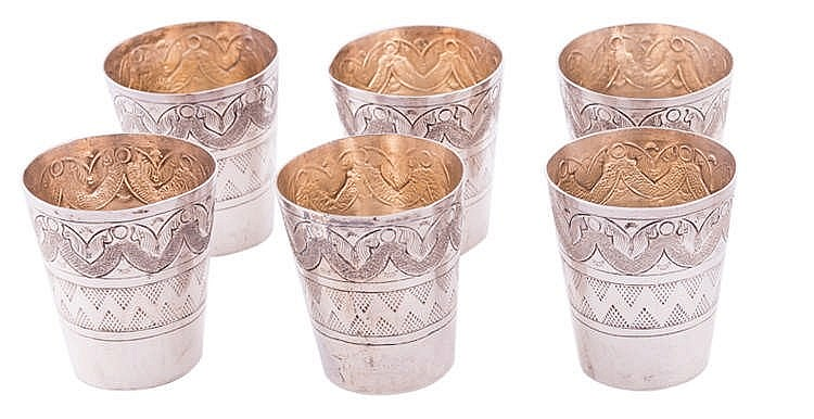 A SET OF SIX SILVER TEA CUPS
