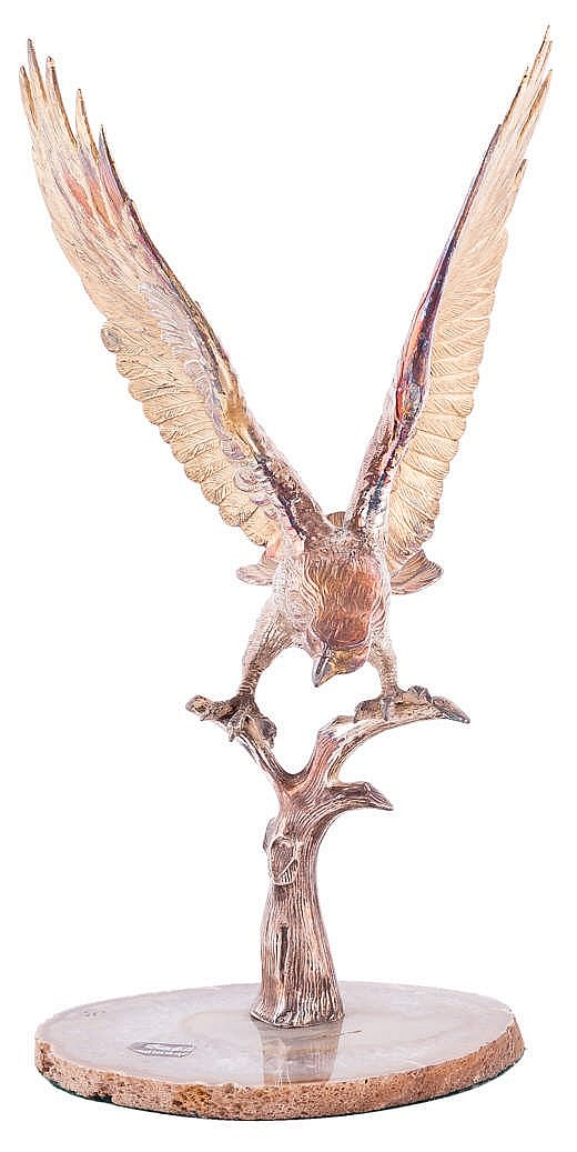 A SILVER GOLDEN EAGLE FIGURE