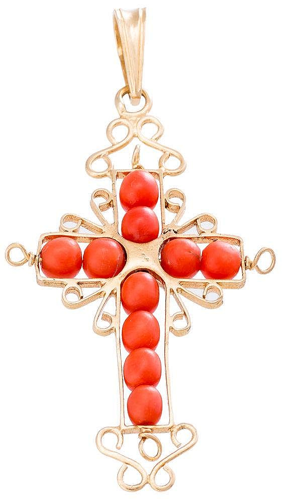 A GOLD AND CORAL PENDANT CROSS